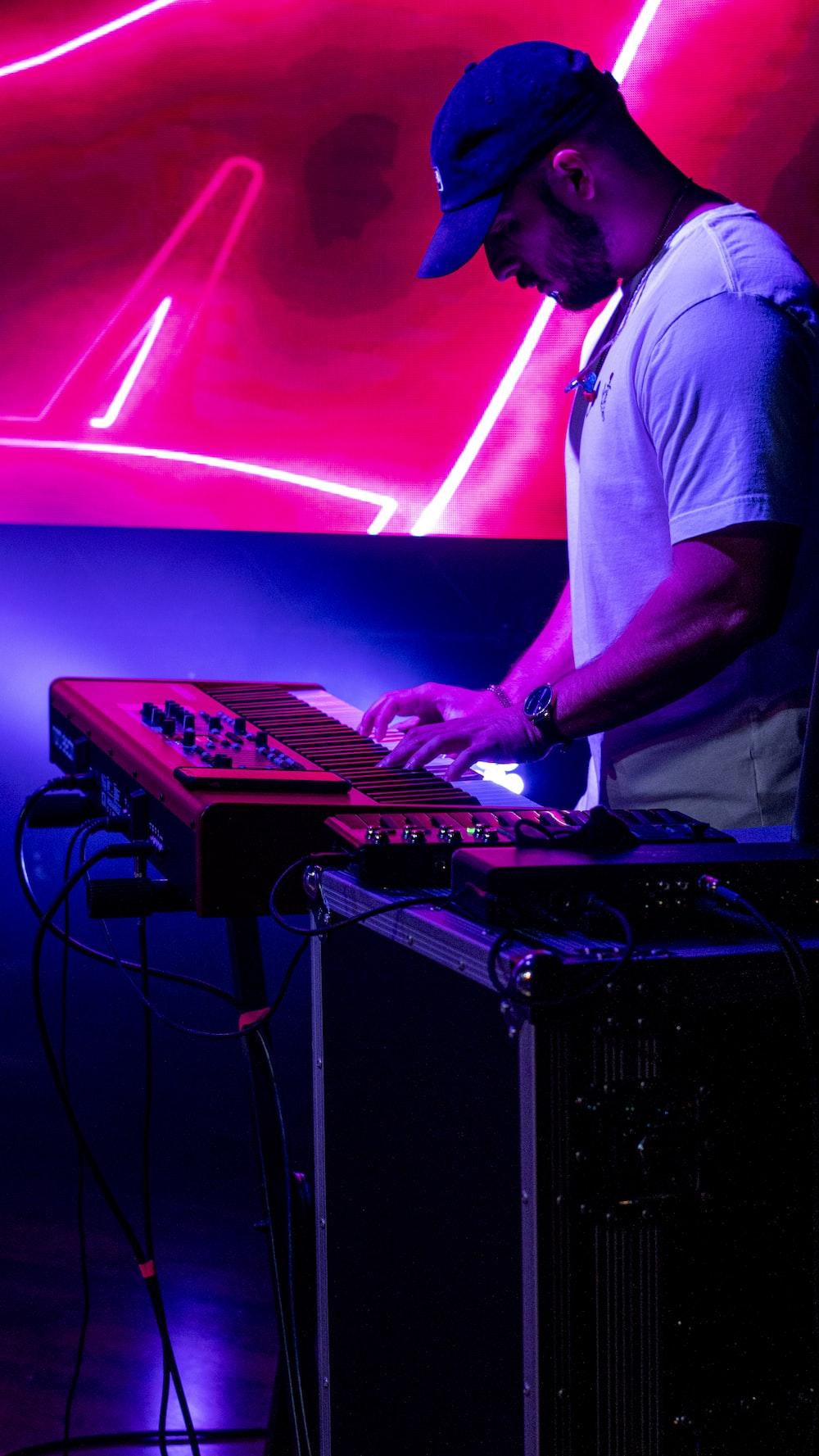 man in white t-shirt playing dj mixer
