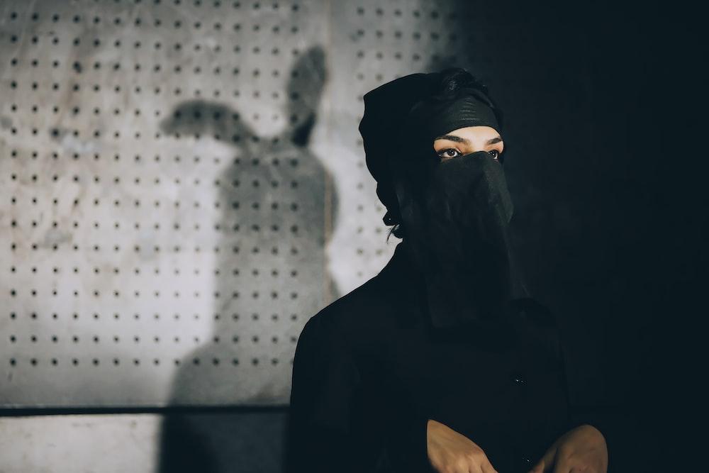silhouette of woman wearing black hijab