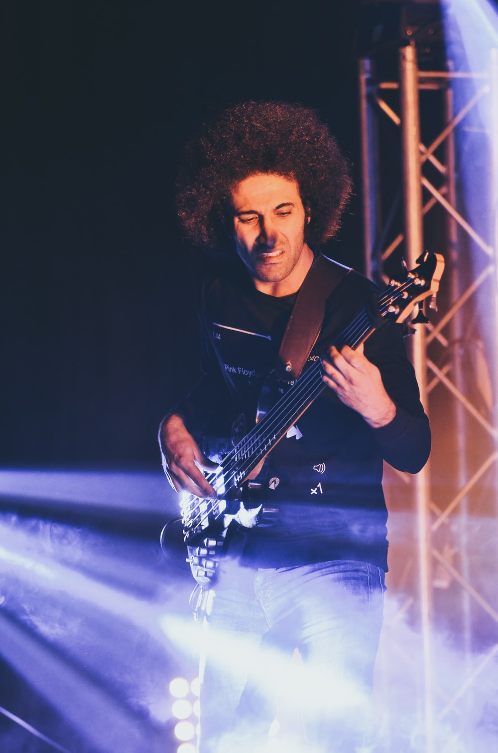man in black button up shirt playing guitar