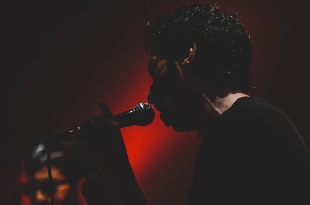 man singing on the microphone