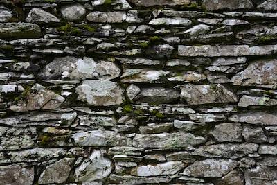 gray and black brick wall blarney stone teams background