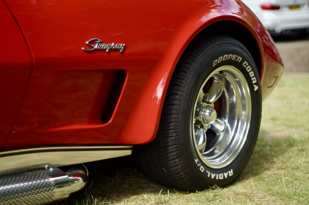 red car with chrome wheel
