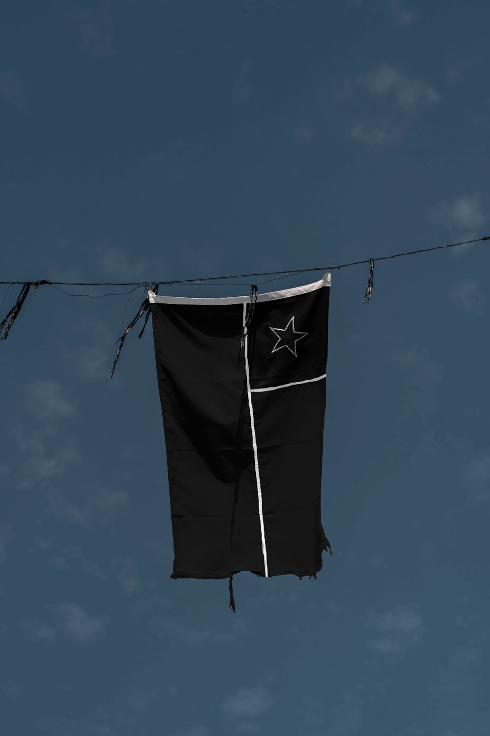 black and white textile hanging on wire