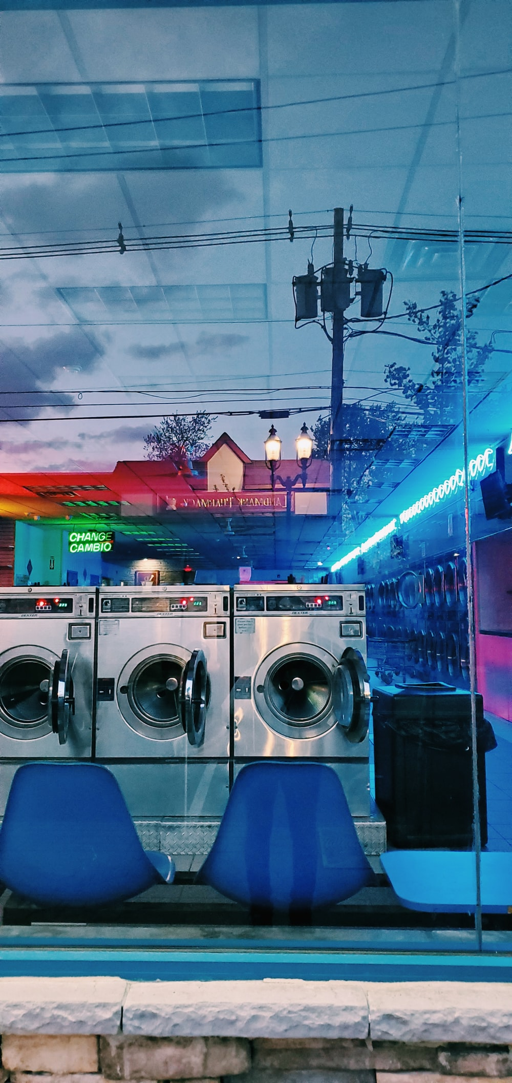front load washing machines near building during night time