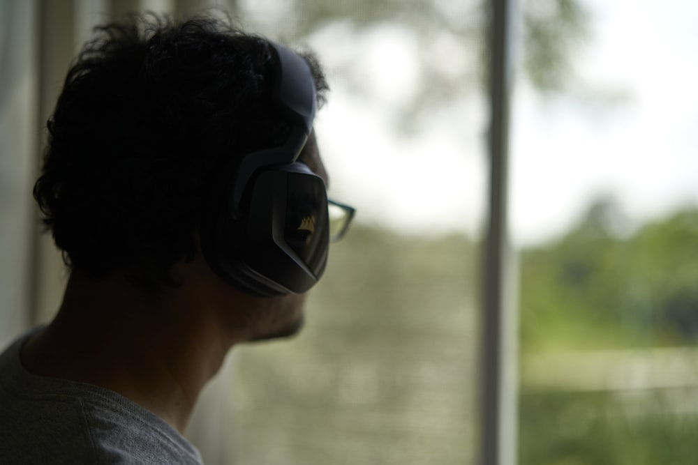 man in grey shirt wearing black sunglasses