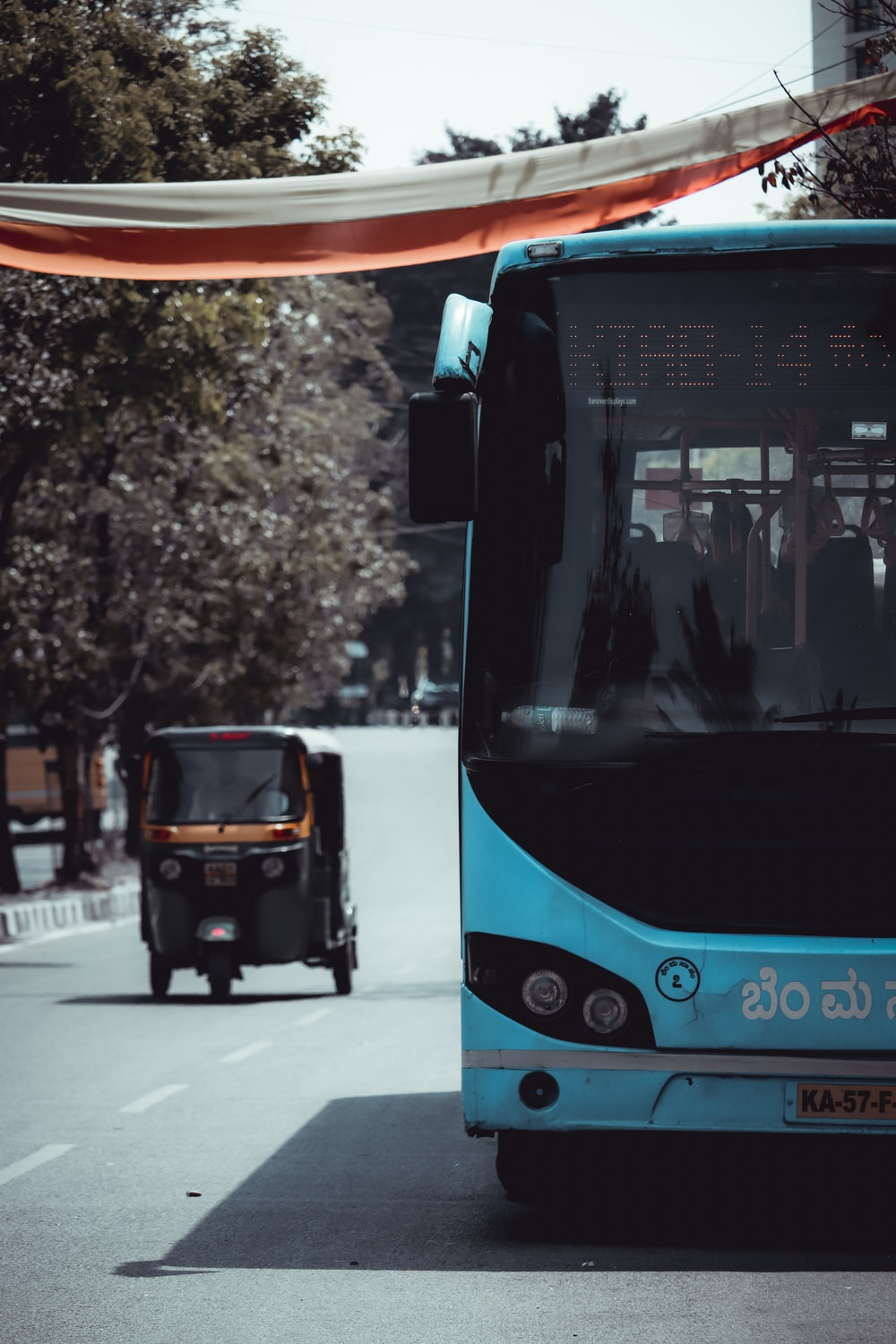 blue and black bus on road during daytime