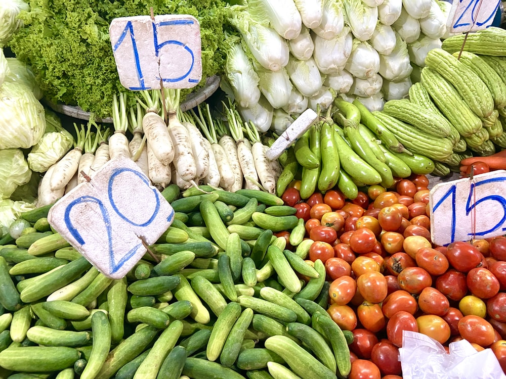 assorted vegetables on blue and white wooden table