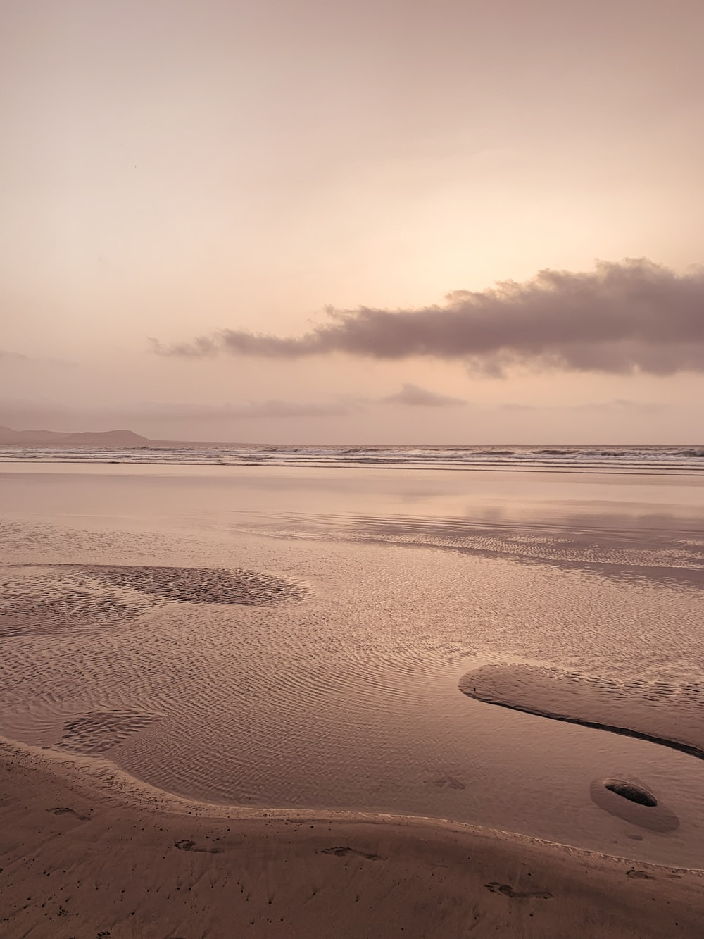brown sand under cloudy sky during daytime