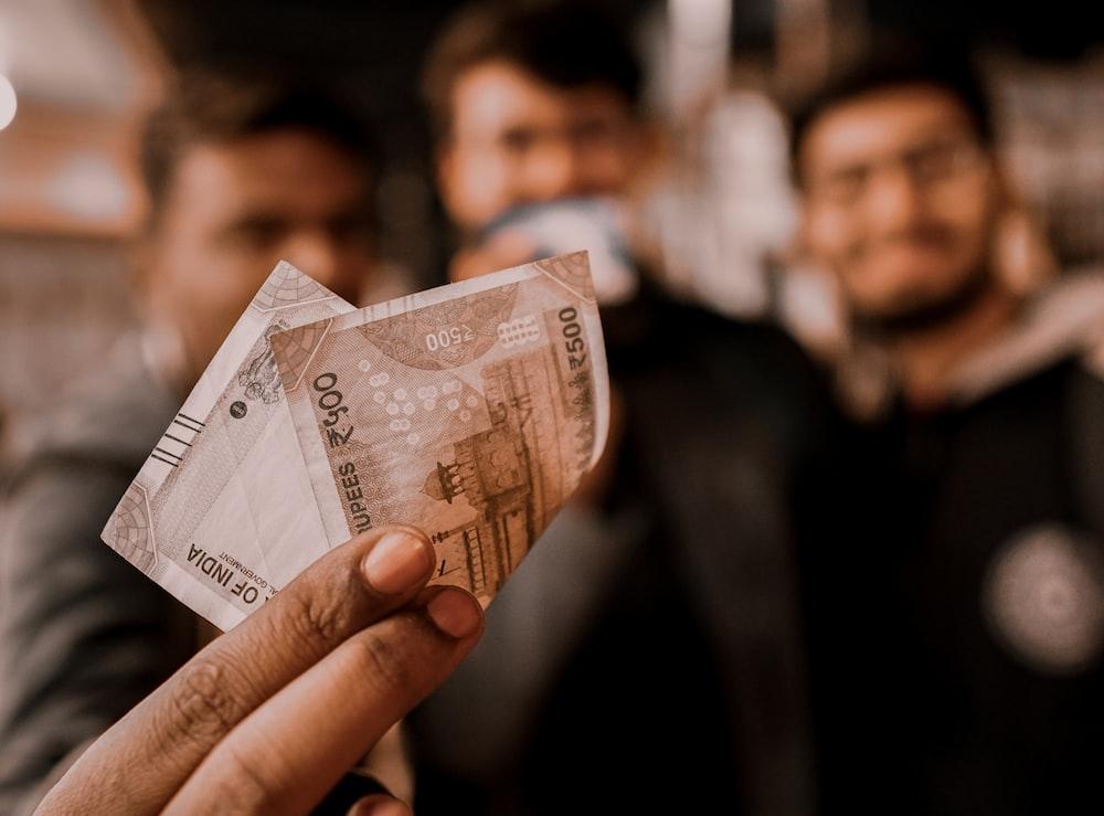 person holding 10 euro bill