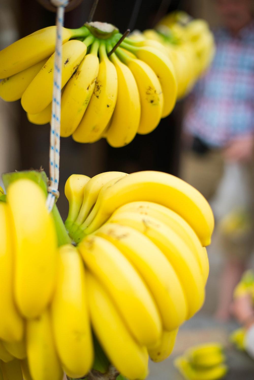 yellow banana fruit on gray metal wire