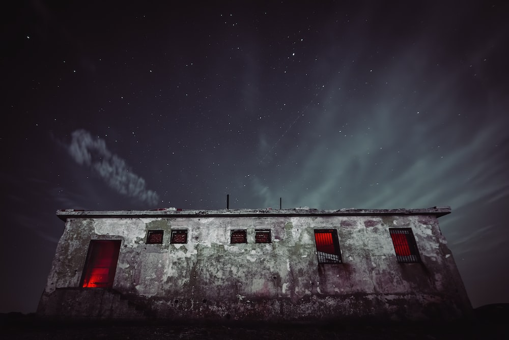 white and red house under starry night