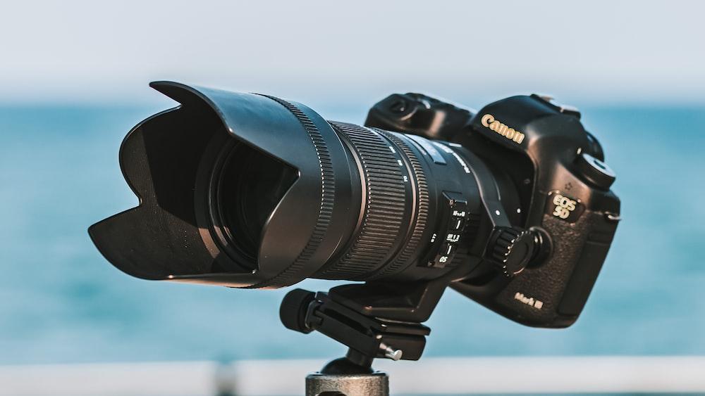 black nikon dslr camera on tripod