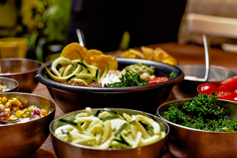 green vegetable dish on brown ceramic bowl