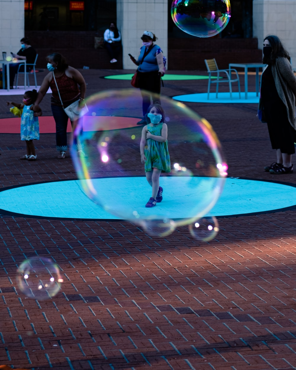 people playing bubbles on blue floor