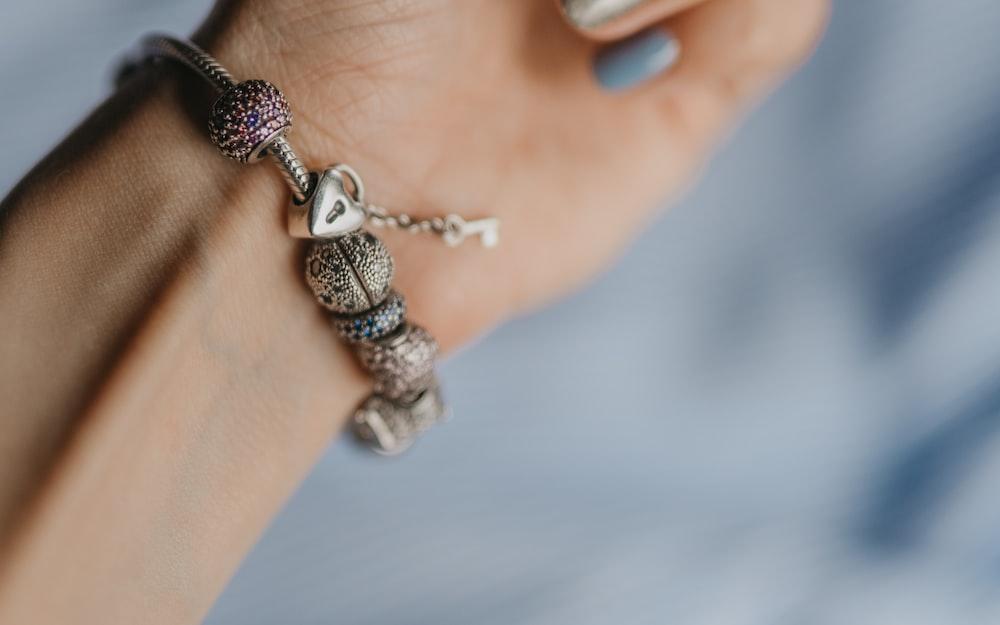 silver and black beaded bracelet