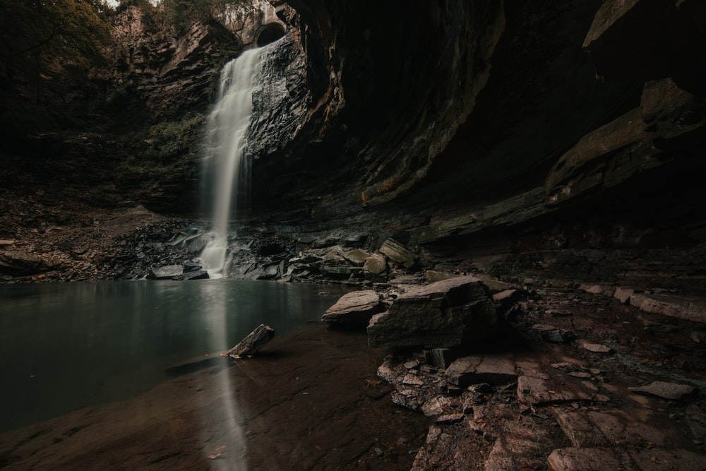 water falls in the middle of a cave