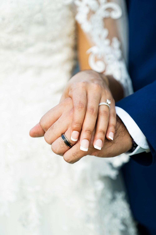 man and woman wearing silver wedding band