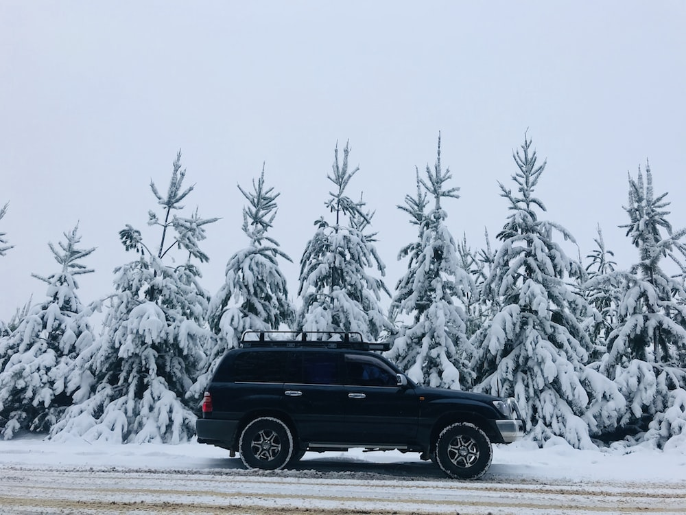 black suv on snow covered road