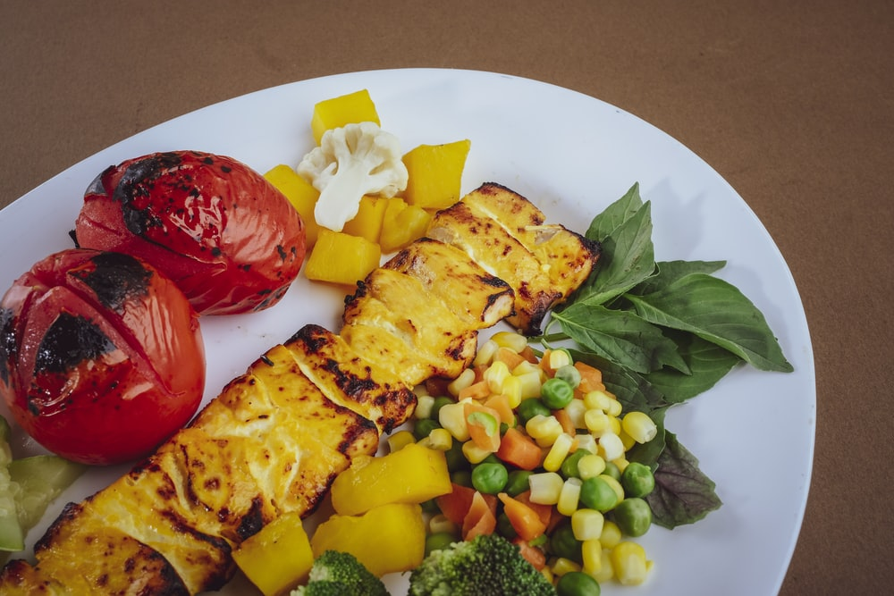 sliced fruit and vegetable salad on white ceramic plate