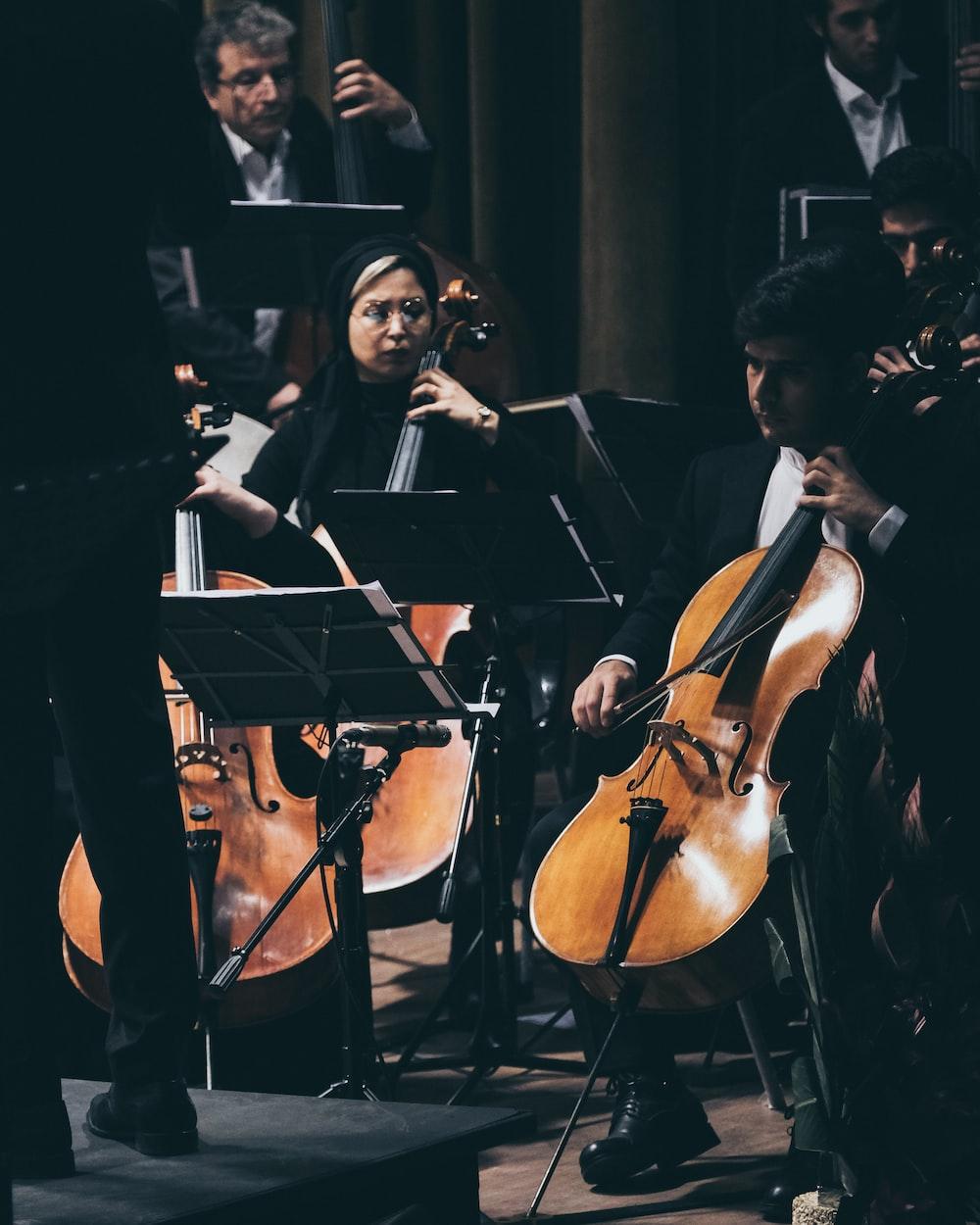 woman in black dress playing violin