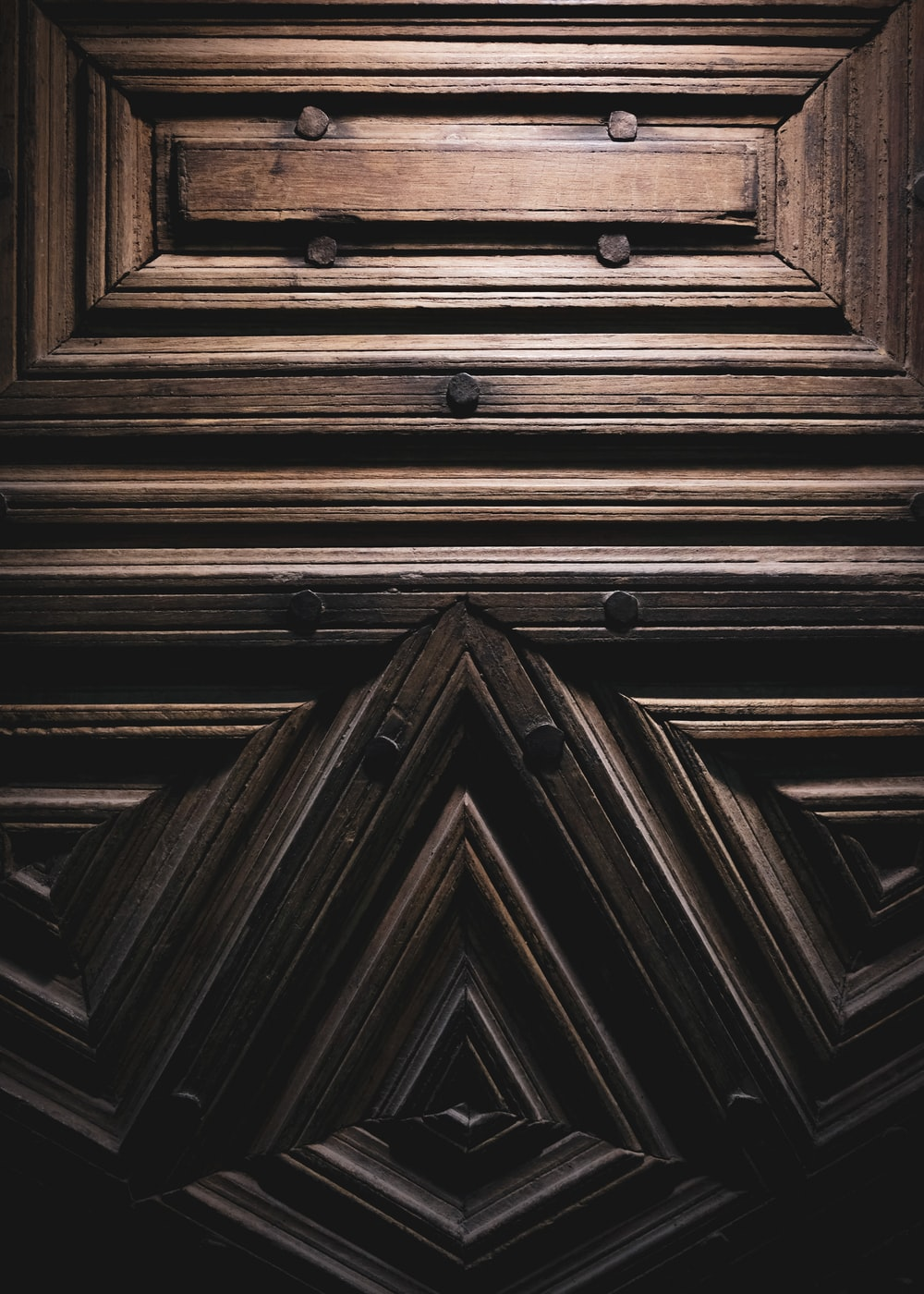 brown wooden door with white door lever