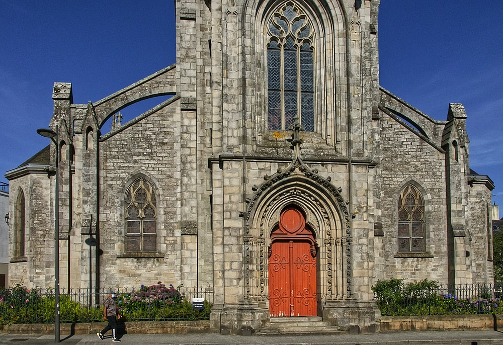 grey concrete church with red door