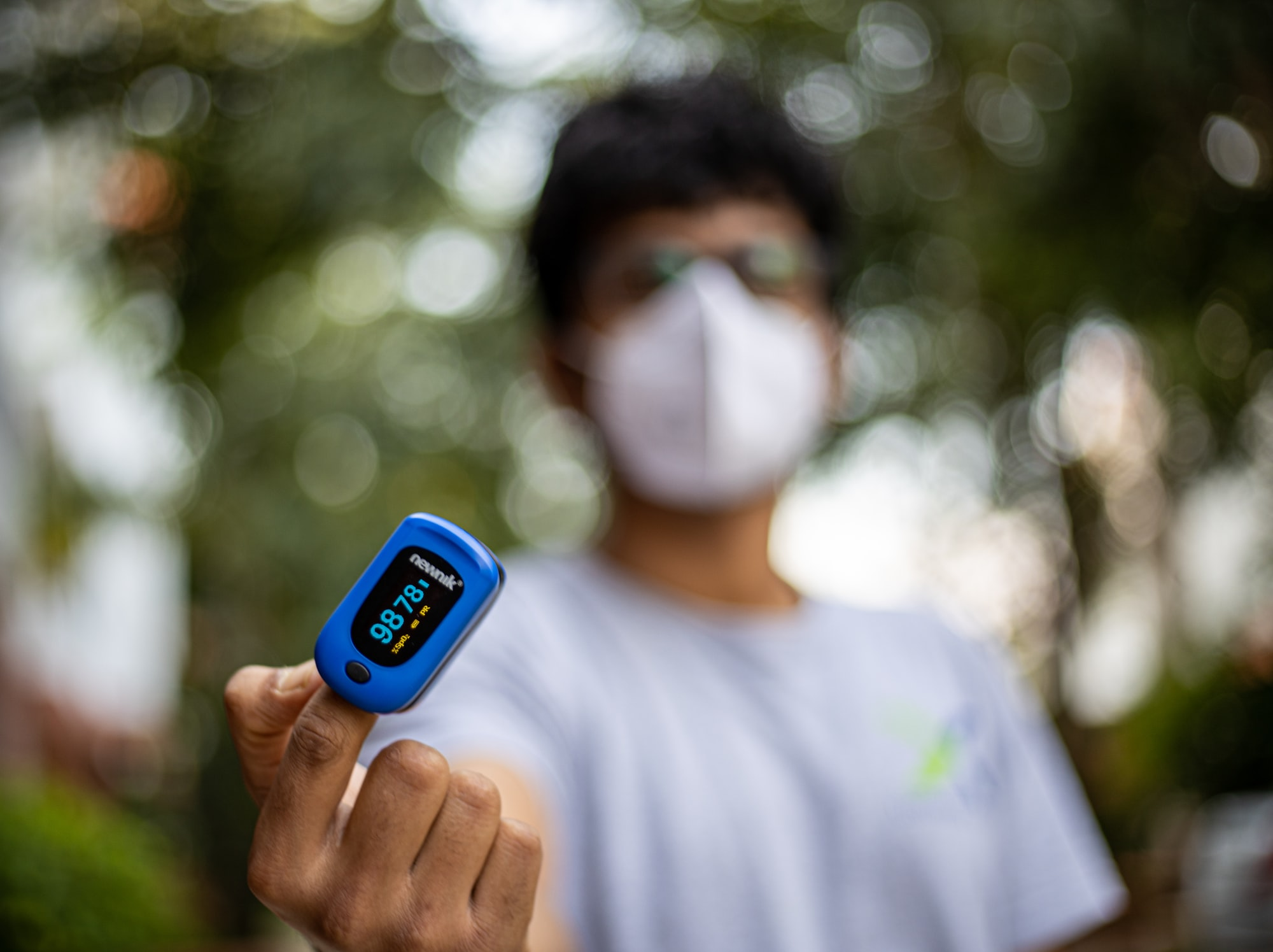 Person with Pulse Oximeter