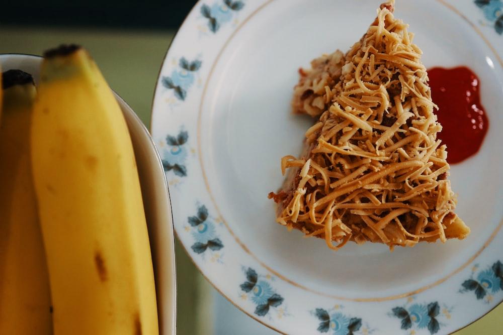 brown pasta on white ceramic plate