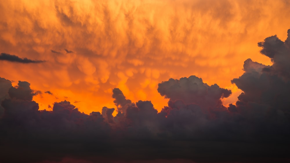 orange and black clouds during sunset