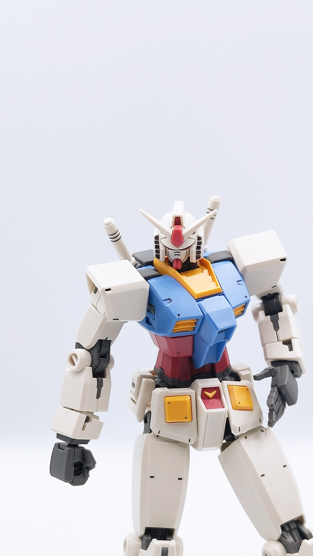 white blue and red robot toy