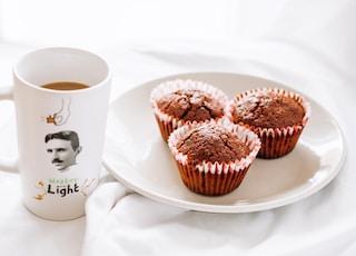 cupcakes on white ceramic plate beside white ceramic mug