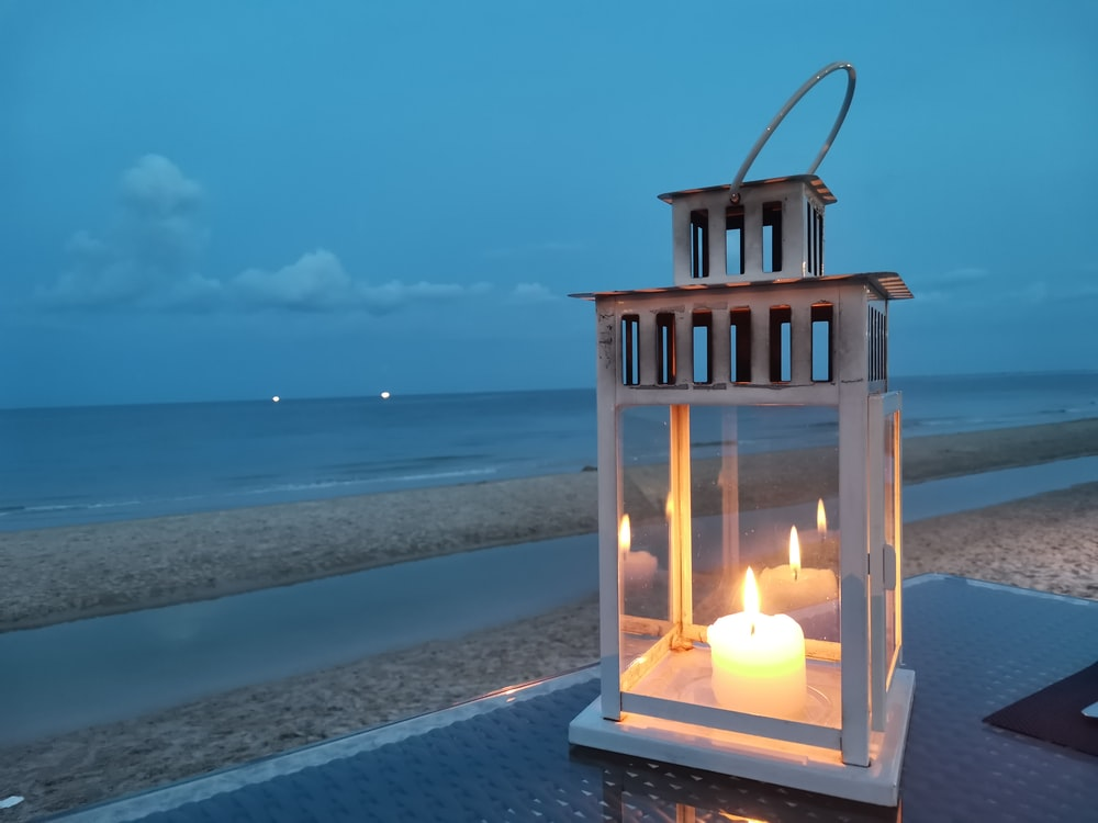 brown wooden candle holder on gray concrete surface