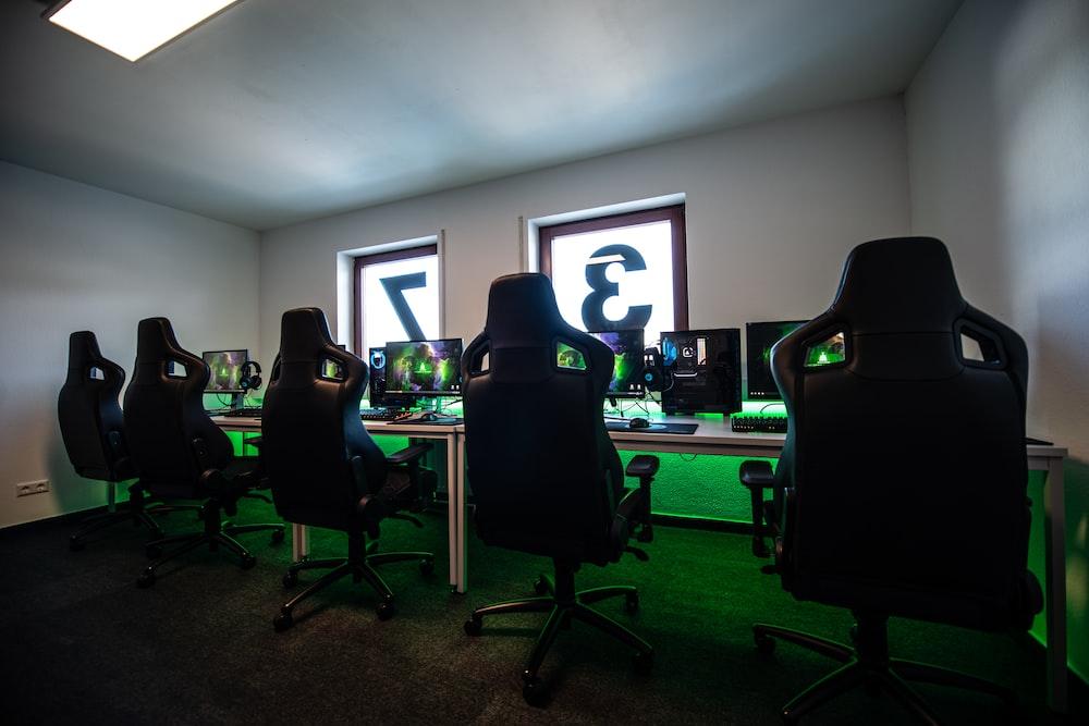 black office rolling chair near black flat screen computer monitor