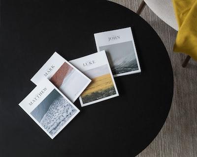 white printer paper on black round table
