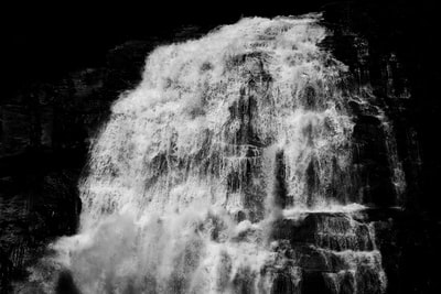 water falls in grayscale photography