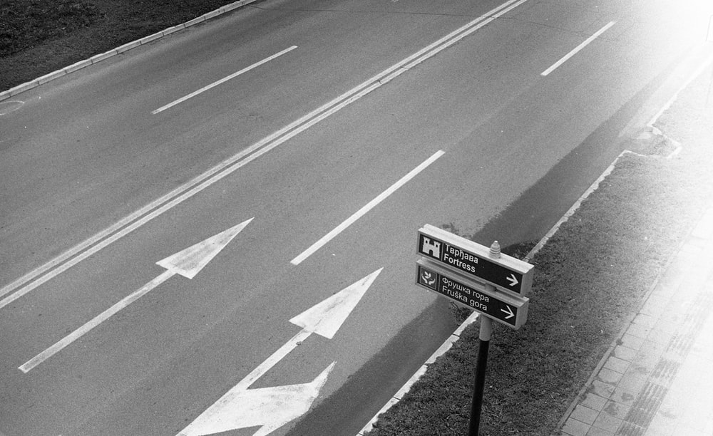 grayscale photo of street sign