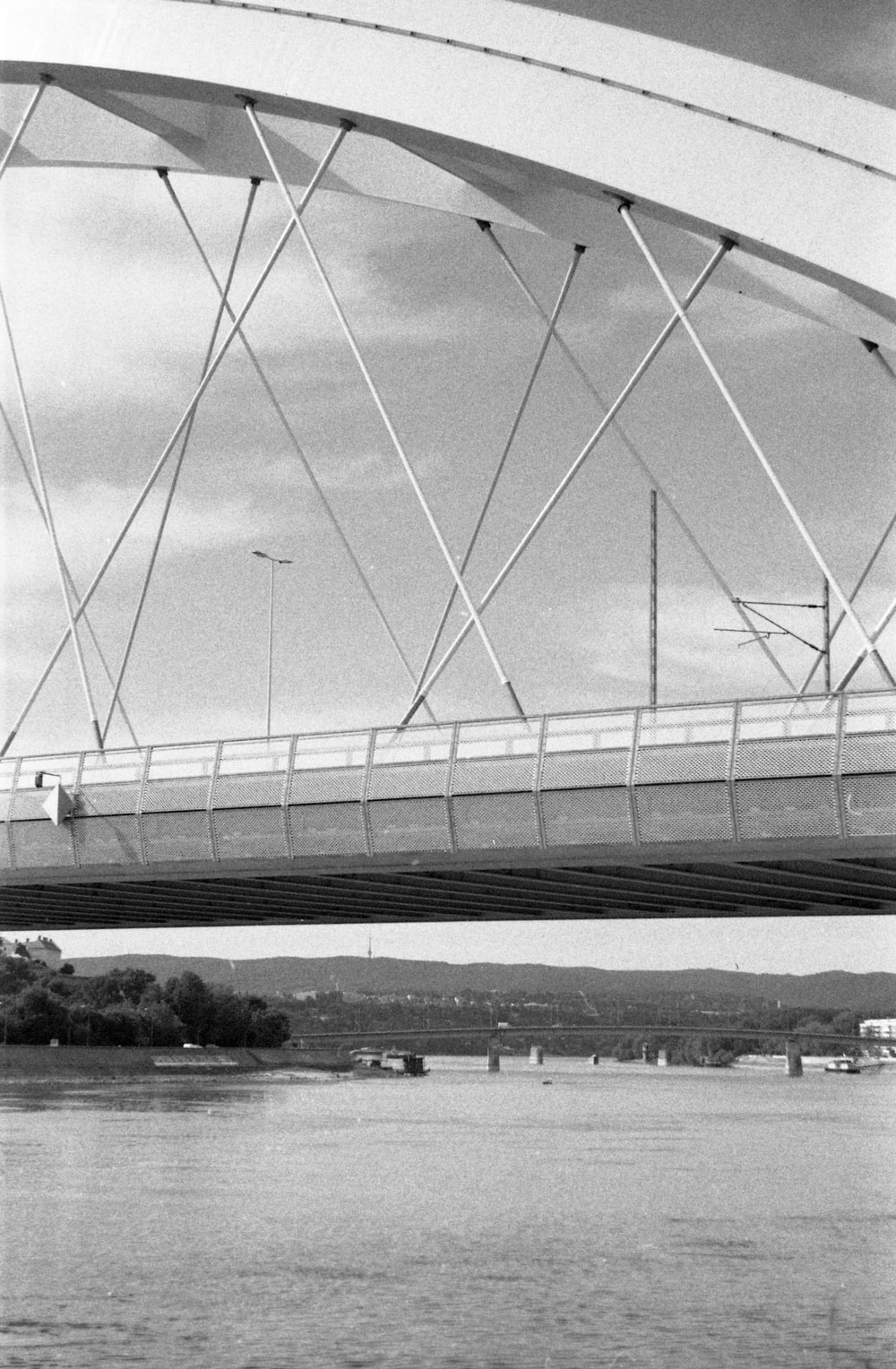 grayscale photo of bridge over river