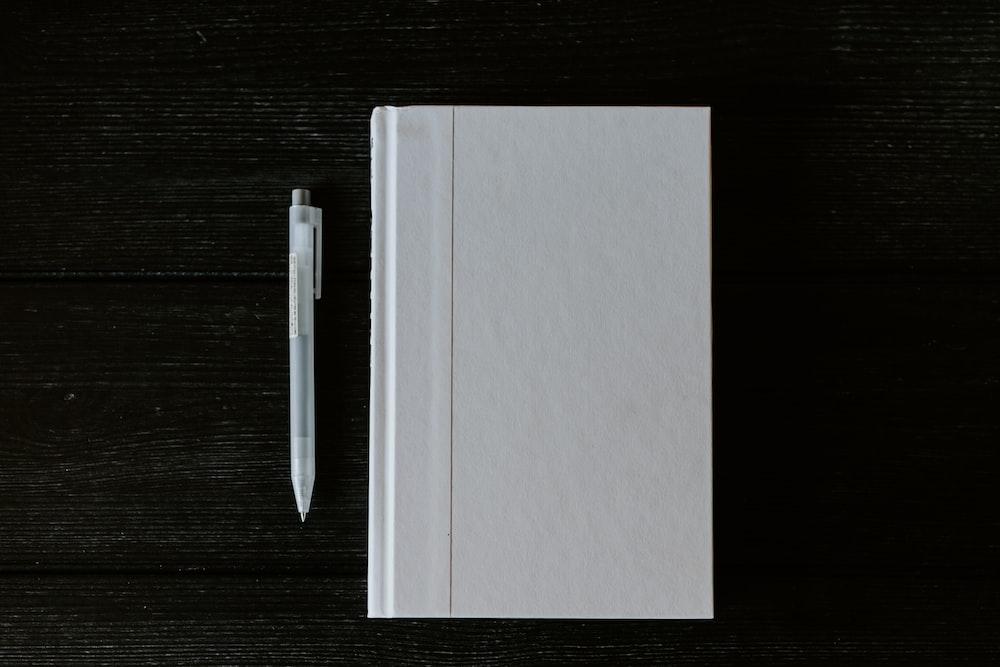 white printer paper on black wooden table