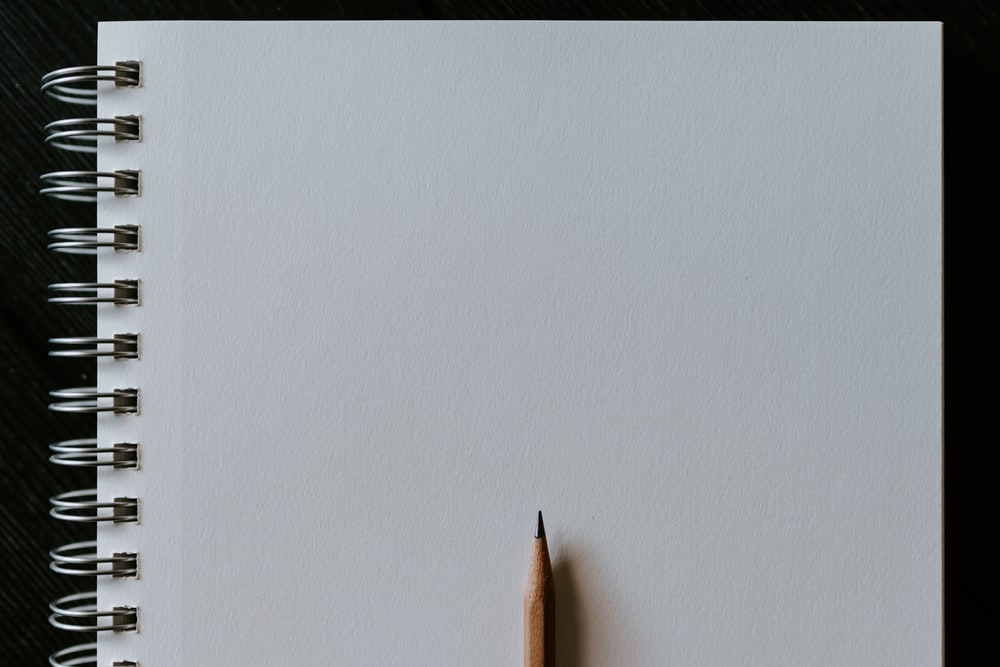 brown pencil on white surface