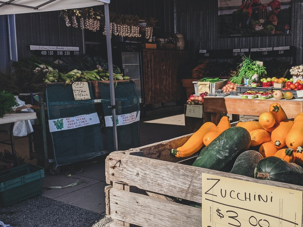 green and yellow vegetable on brown wooden crate