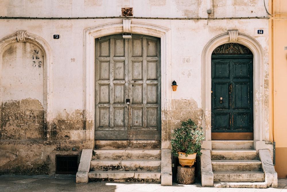 brown wooden door on white concrete building