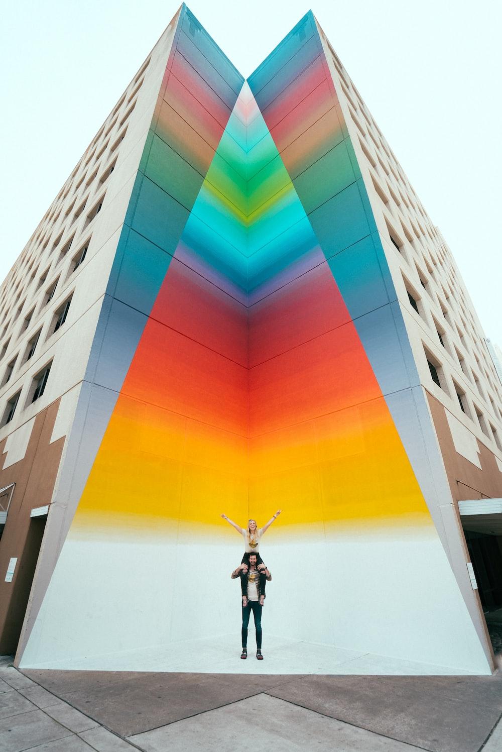 man in black jacket standing on building