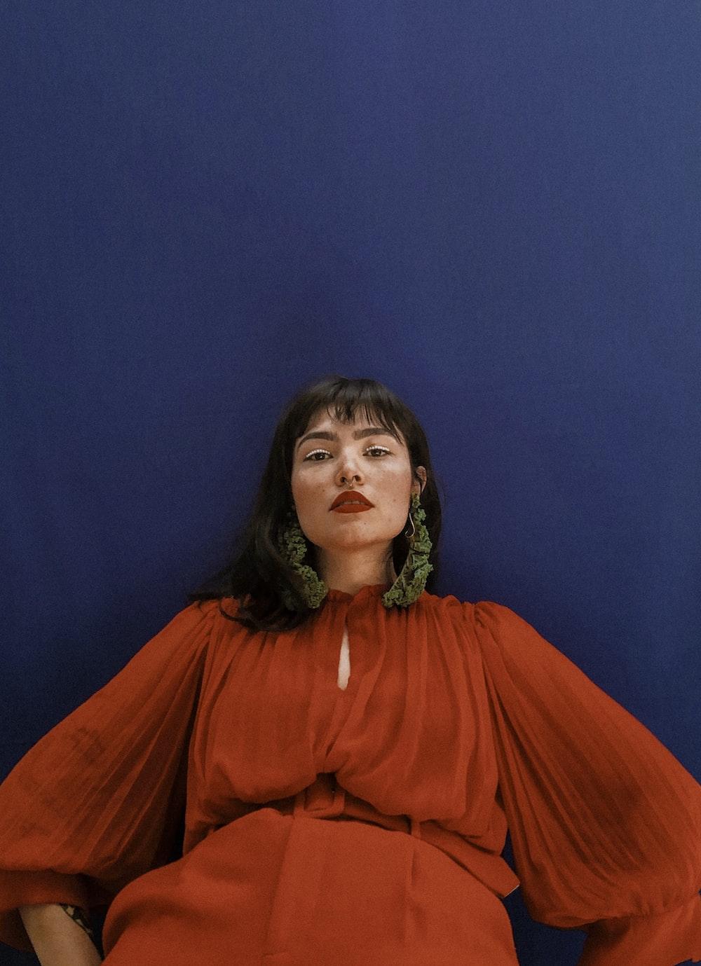 woman in orange long sleeve dress