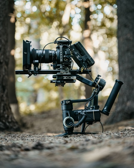black video camera on brown soil