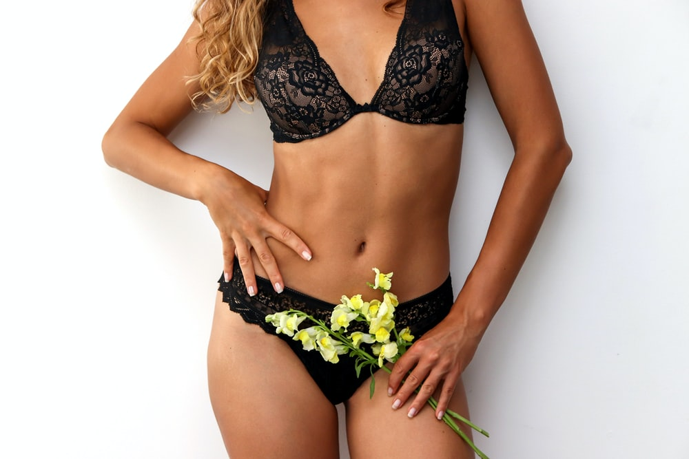 woman in black and white floral bikini