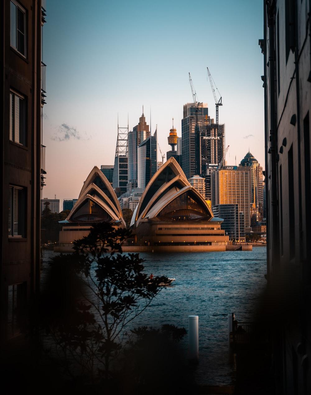 body of water between buildings during daytime