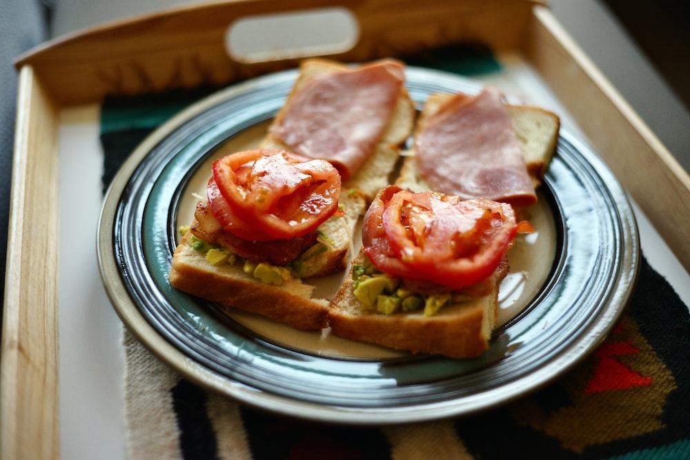 sliced ham on bread on white ceramic plate