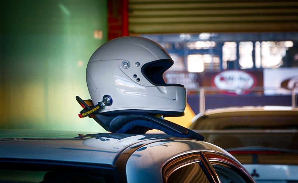 white and black motorcycle helmet