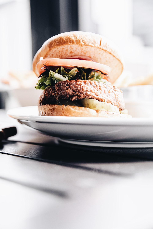 burger on white ceramic plate
