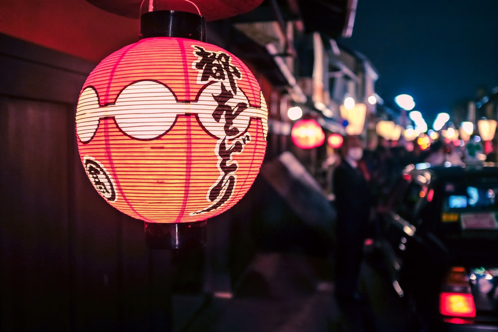 red and white lantern during night time